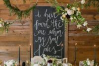 28 oversized hoops with flowers and greenery over the table
