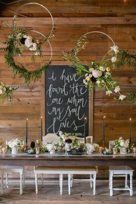 oversized hoops with flowers and greenery over the table