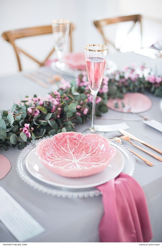 pink and grey wedding table with gold rimmed champagne glasses