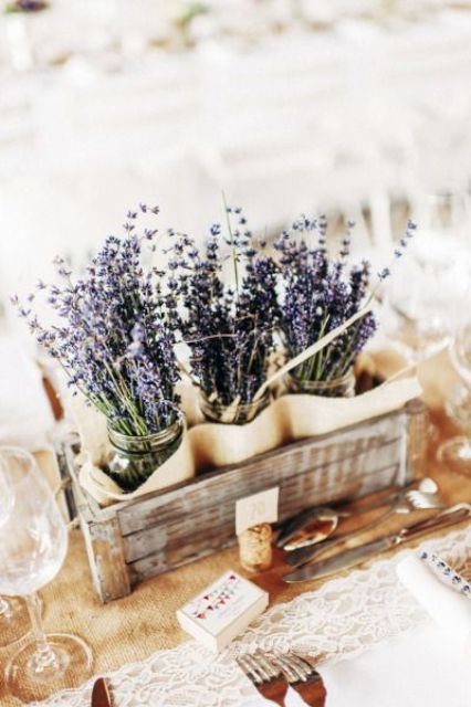 rustic centerpiece of a crate and lavender in jars
