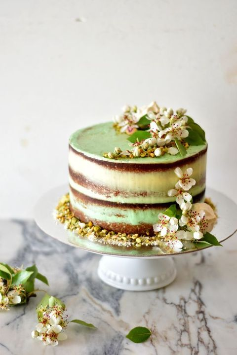 semi-naked wedding cake with pistachios and lime