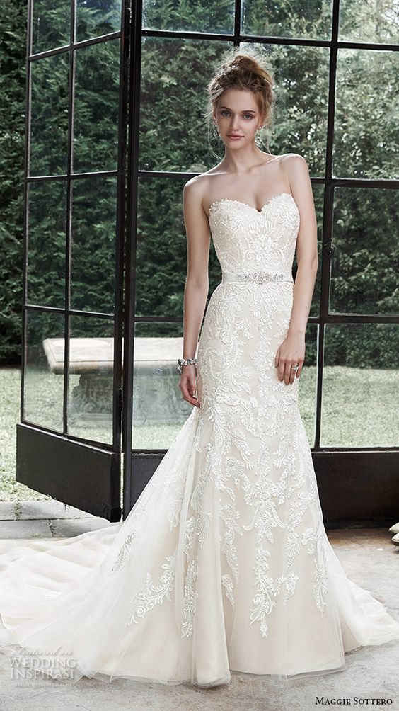 sheath lae strapless wedding dress with a train and an ebellished sash