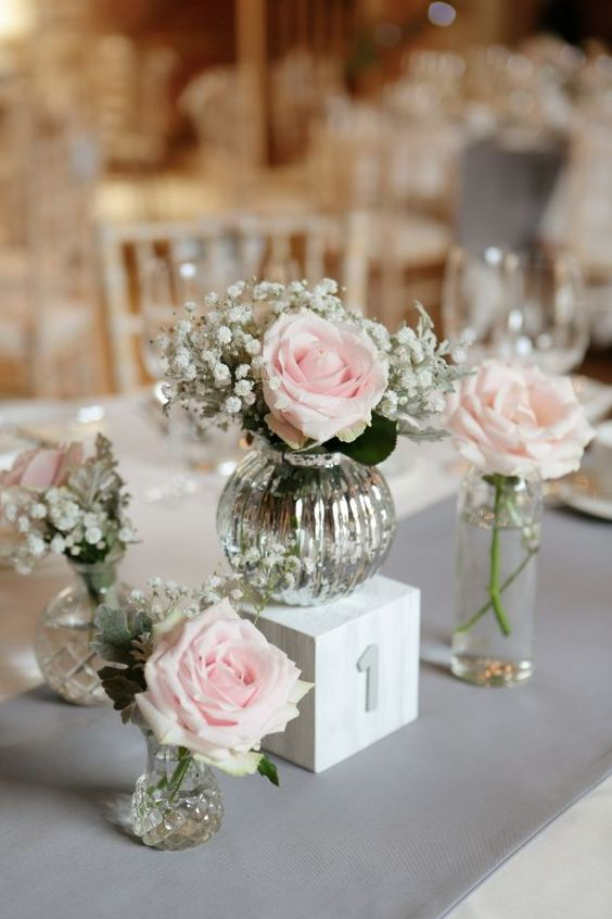 mercury glass vases with blush roses and baby's breath