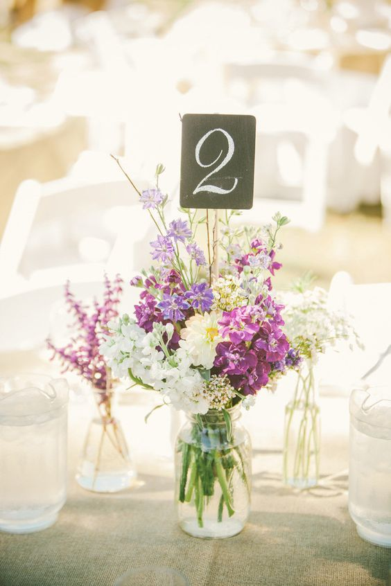 wildflower centerpiece with a chalkboard table number