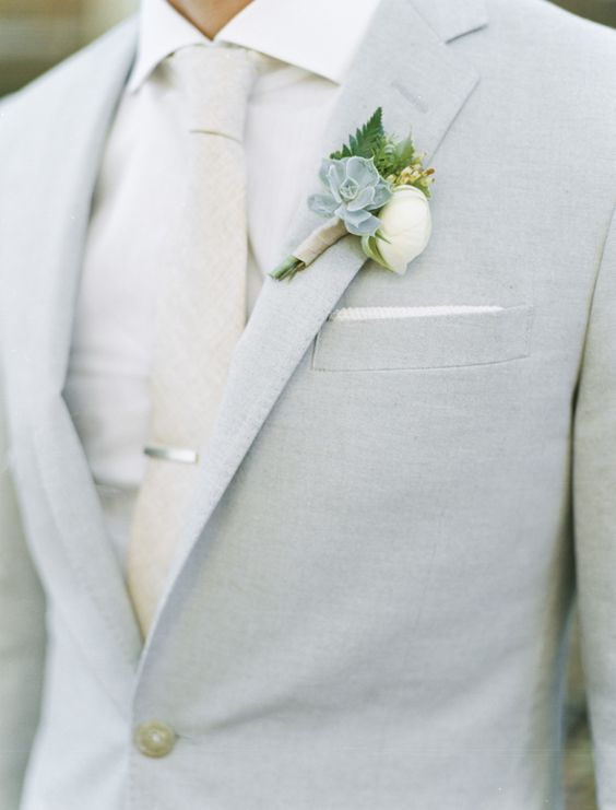 light grey suit with a cream tie and shirt, a succulent boutonniere