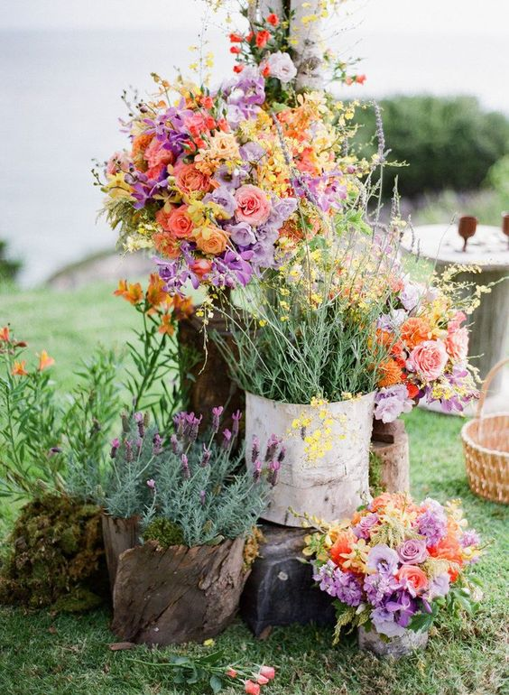 masses of wildflowers and just garden flowers for an outdoor ceremony