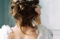 30 messy updo with a botanical-inspired headpiece