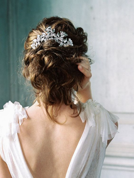 messy updo with a botanical inspired headpiece