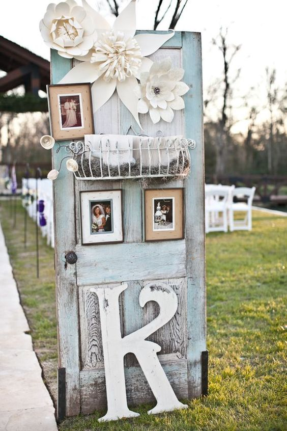 patina-colored door with photos and monograms for wedding decor