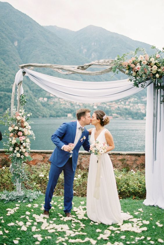 rustic wedding arch with tulle and florals