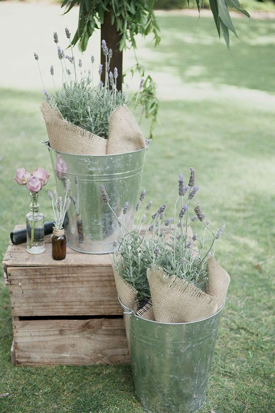 silver buckets of lavender and burlap for rustic wedding ceremony