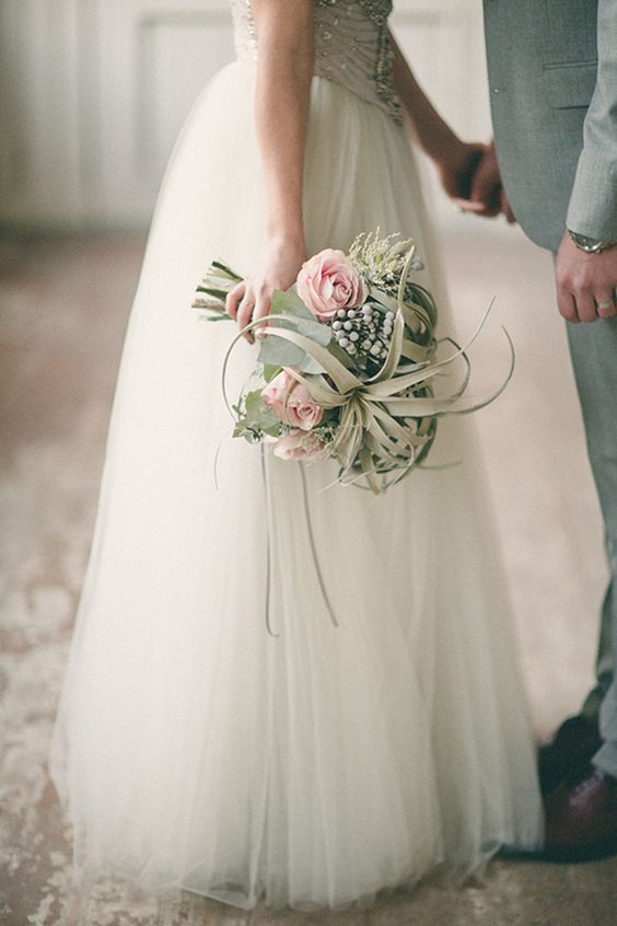 dusty, grey wedding bouquet with air plants and pink roses