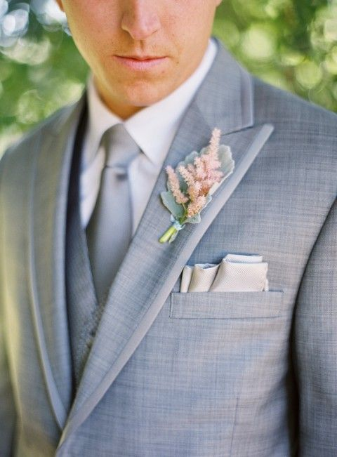 light grey suit with a vest and tie, blush boutonniere