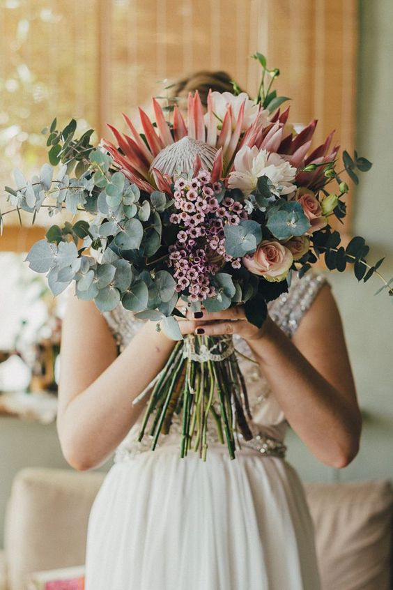 lush eucalyptus and protea bouquet for a boho wedding