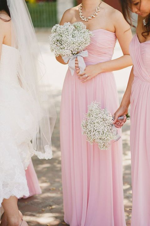 pink strapless gowns wwith baby's breath bouquets