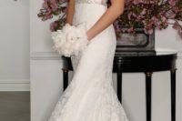 31 sleeveless ivory wedding dress with plunging neckline, lace illusion back and beaded belt by Romona Keveza