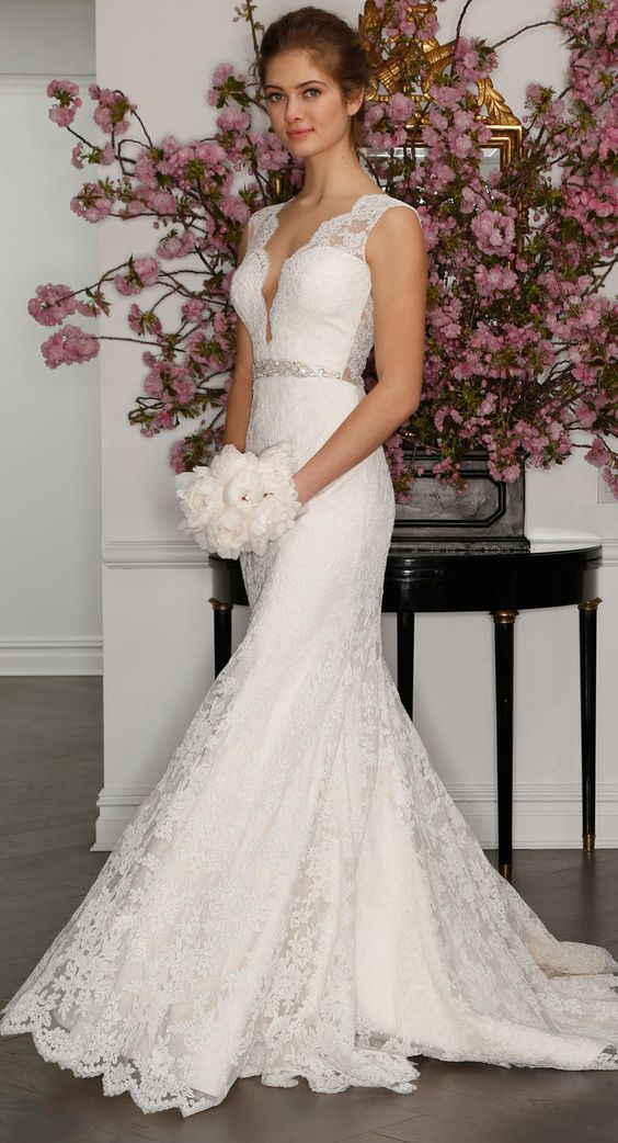 sleeveless ivory wedding dress with plunging neckline, lace illusion back and beaded belt by Romona Keveza