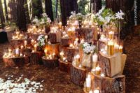 31 spring woodland wedding ceremony spot with candles and flowers