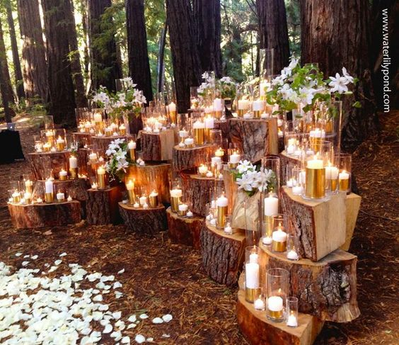 spring woodland wedding ceremony spot with candles and flowers