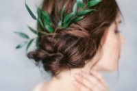 31 twisted updo with a fresh green sprig