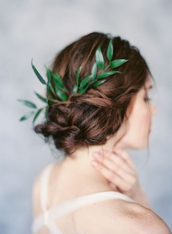twisted updo with a fresh green sprig