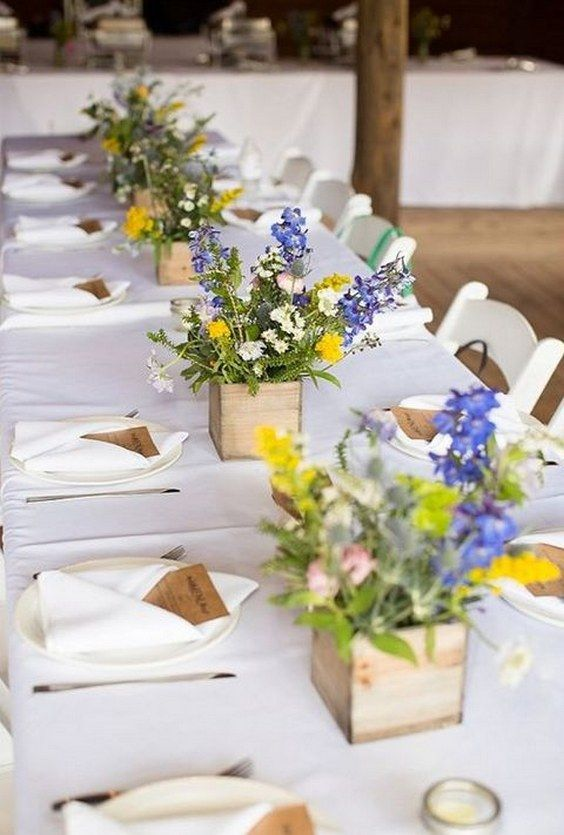 wooden boxes with wildflowers as rustic centerpieces