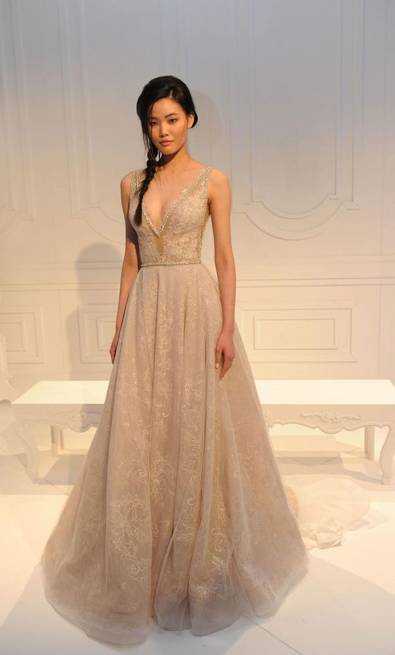 extravagant champagne gown with a plunging neckline by Glia Lahav