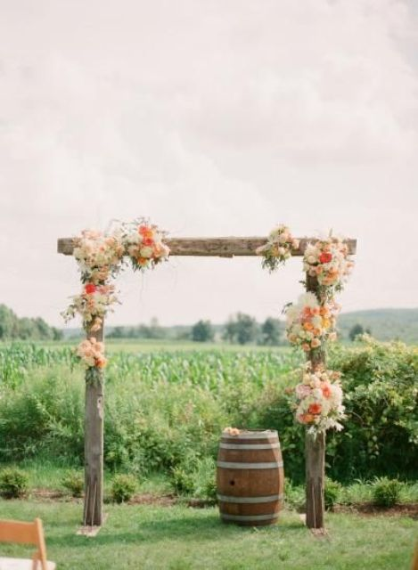 rustic arch decorated with flowers