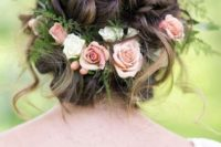 32 wavy and twisted updo with fresh flowers and greenery