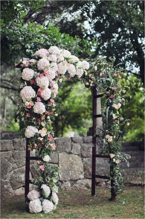 dark ladder arch with pink and blush hydrangeas looks luxurious