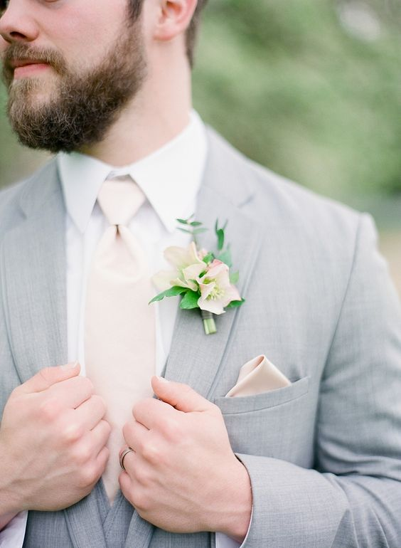light grey suit, a blush tie and boutonniere
