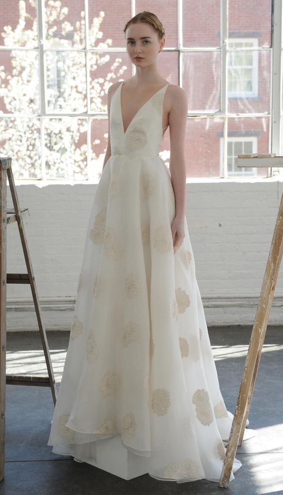 plunging neckline gown with gold floral details by Lela Rose