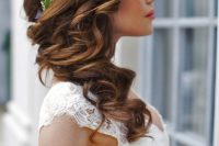 34 curled side swept hairstyle with a floral crown