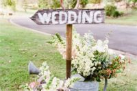 34 rustic DIY spring wedding signs with watering can planters