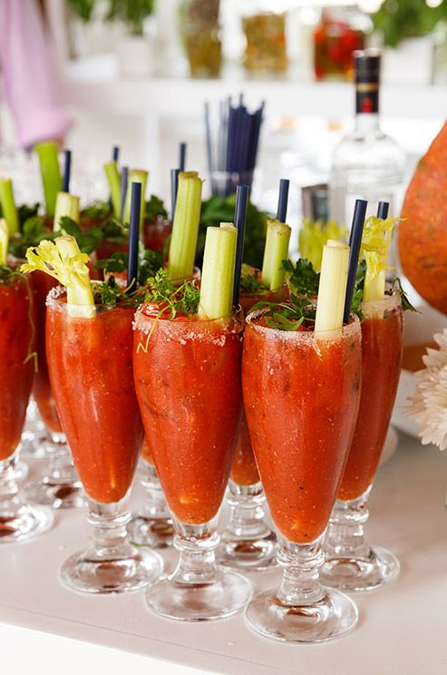 fresh bloody marys are topped with celery sticks and herbs