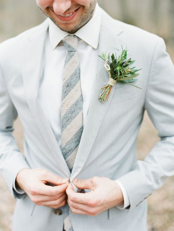 light grey suit, a white shirt and a striped tie