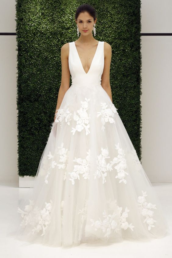 wide strap deep plunging neckline wedding dress with a floral applique skirt