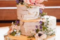 36 birch log wedding cake topped with flowers