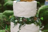 36 buttercream wedding cake with greenery and moss
