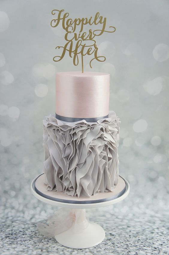 unique grey ruffle and pink layer wedding cake with a calligraphy topper
