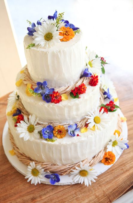 bright wildflowers on a frosted wedding cake