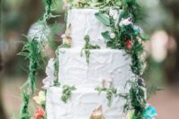 37 cream wedding cake with lush floral and greenery decor