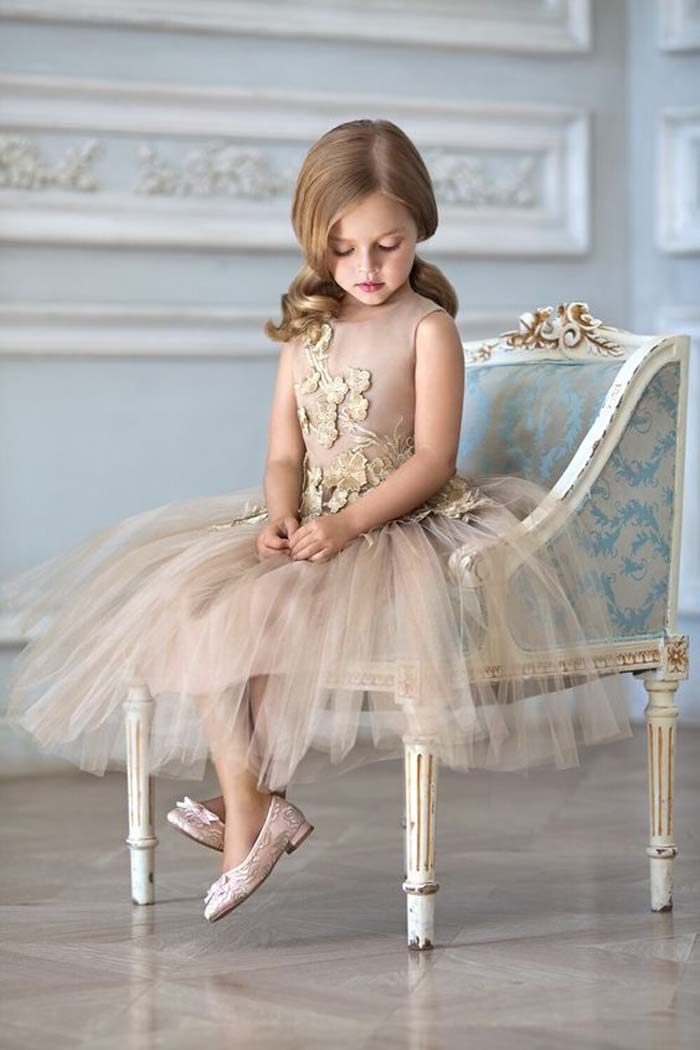 powder-colored dress with gold lace flower appliques and a layered tulle skirt