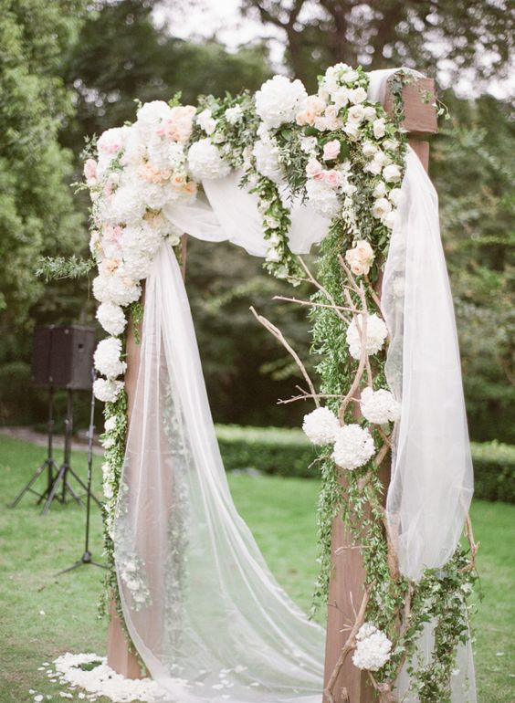 rustic arch with tulle and white and blush hydrangeas