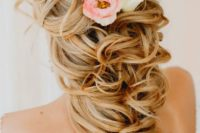 37 side swept hairstyle with air plants and flowers