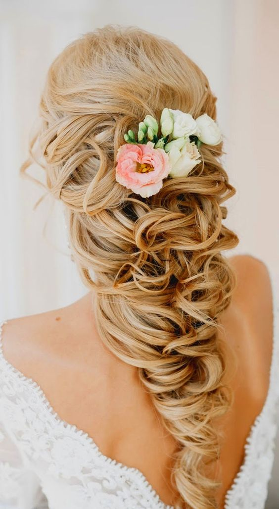 side swept hairstyle with air plants and flowers