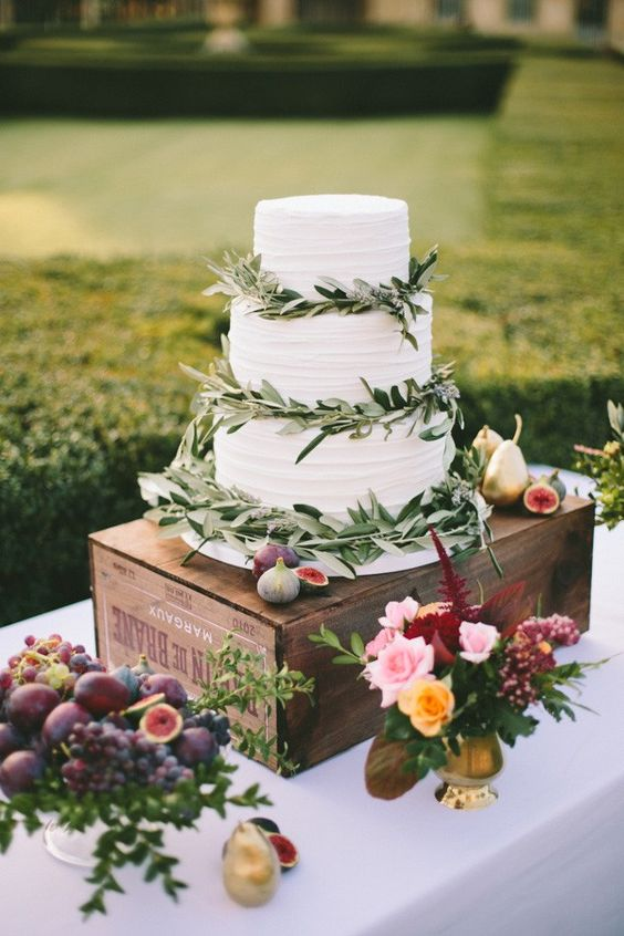 white cake with leafy decor