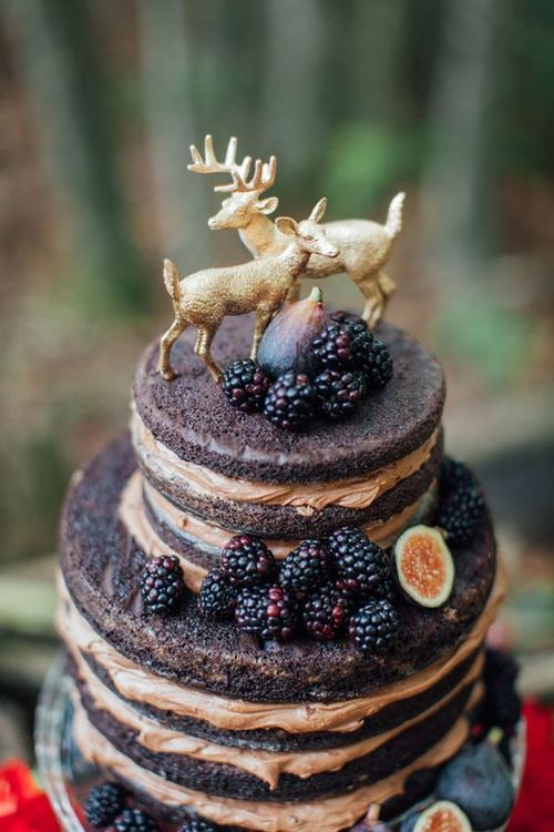 naked wedding cake with blackberries and figs