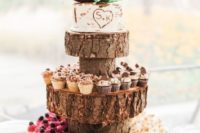 38 rustic wood slice cupcake stand and a bark-styled wedding cake