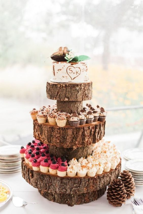rustic wood slice cupcake stand and a bark-styled wedding cake